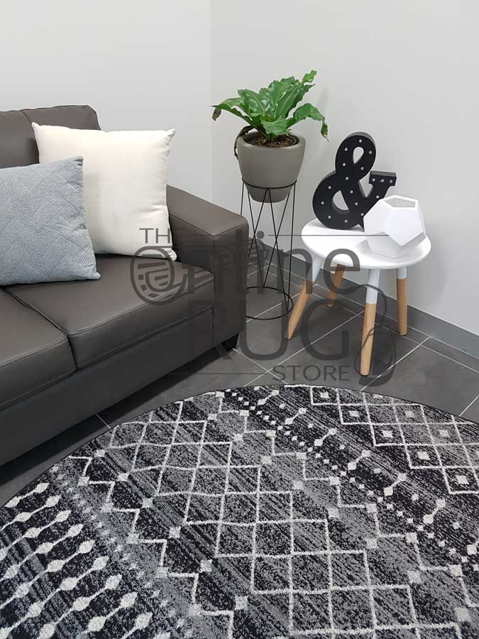 Awaken Black Tribal Power Loomed Round Rug