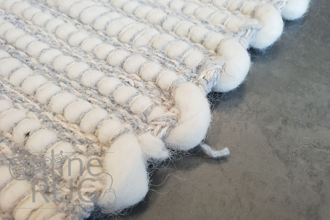 Lotta Grey and Natural White Felted Wool Rug